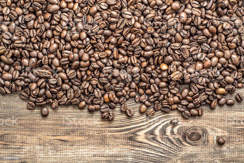 Background texture with coffee beans on wood with copy space. stock photo