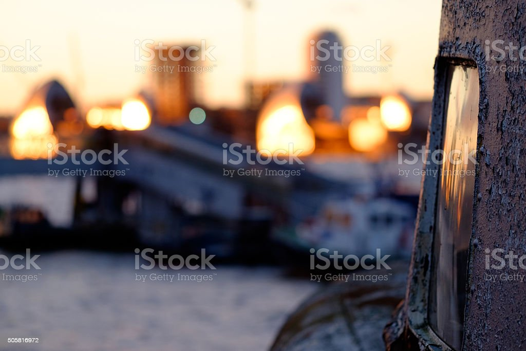 Background Thames barrier and old boat stock photo