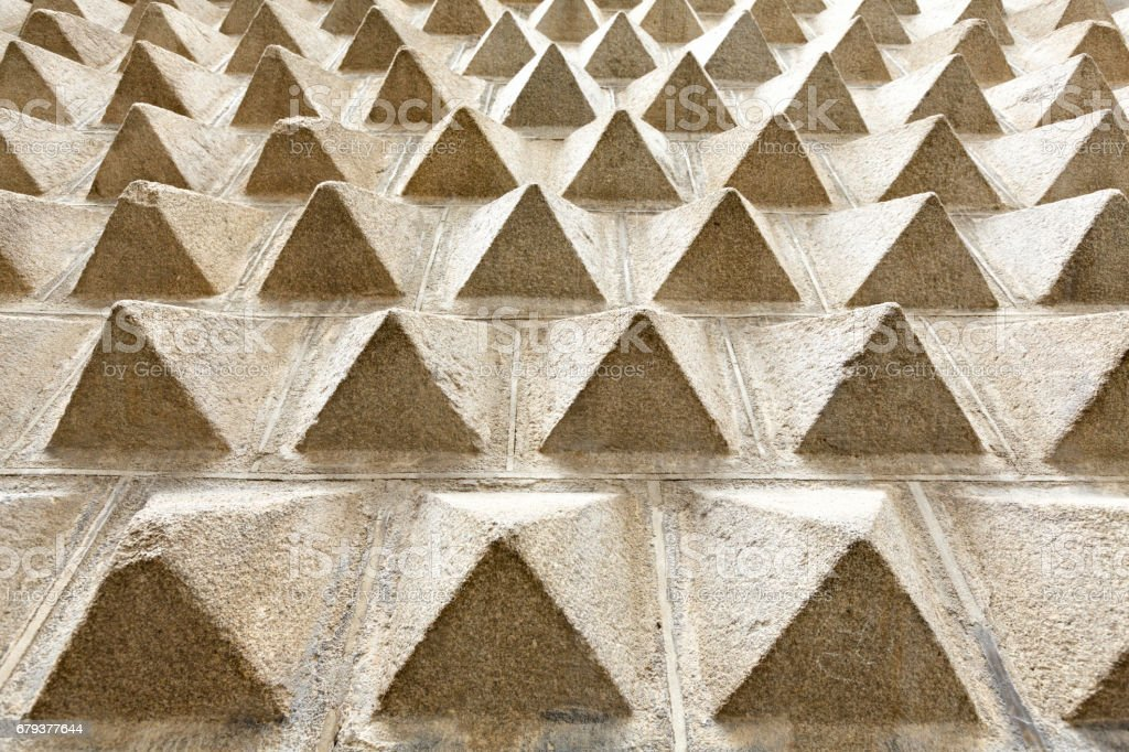 Background wall full of pyramid forms stock photo