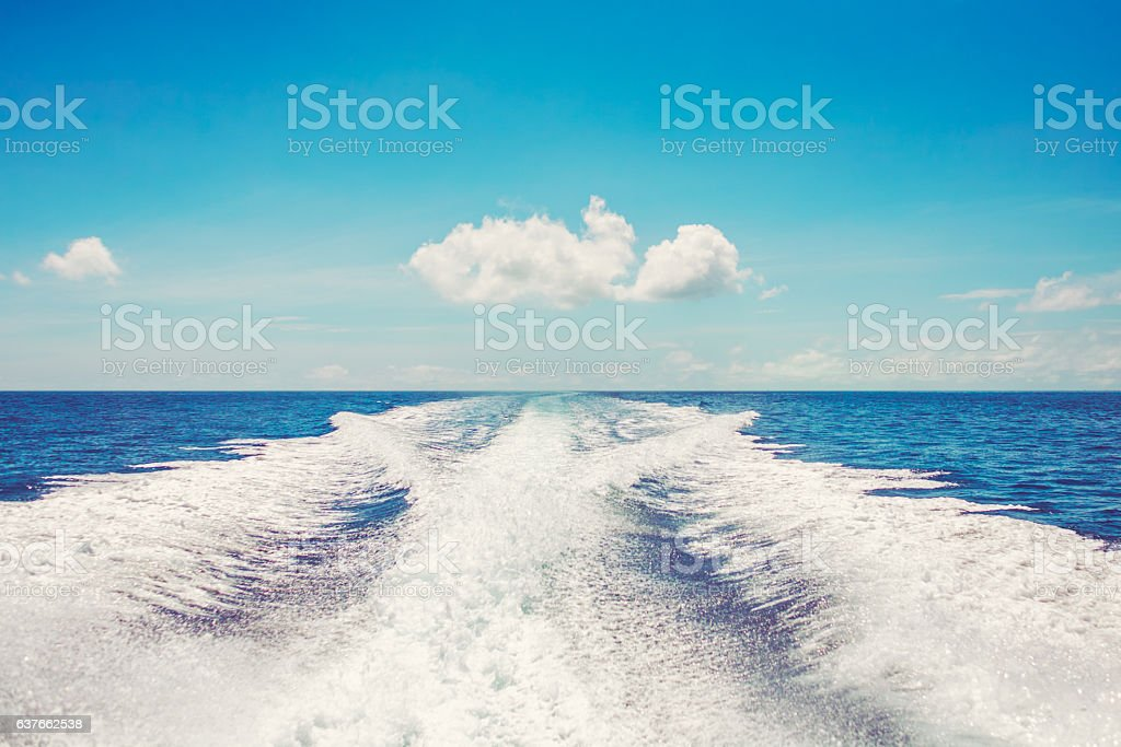 Background water surface behind fast moving motor boat vintage retro stock photo