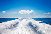 Background water surface behind of fast moving motor boat