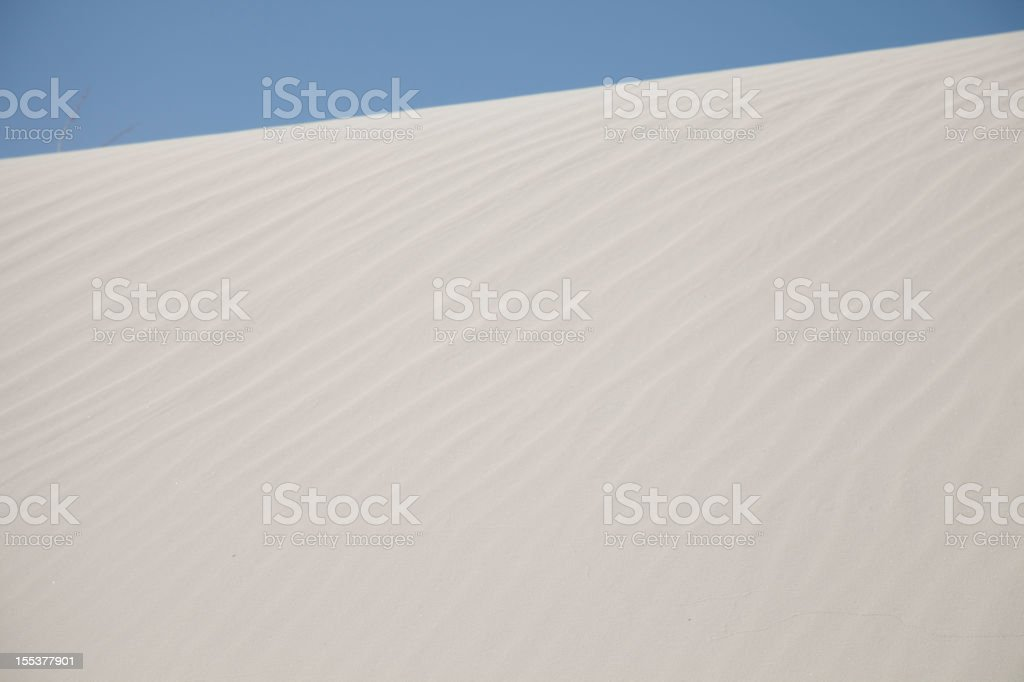 background - white sand with blue sky stock photo