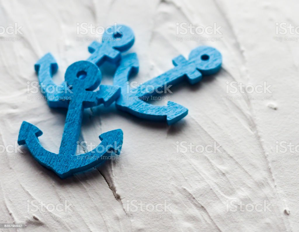 Background with decorative anchors and wheels on a white painted background. Place for text. Top view with copy space stock photo