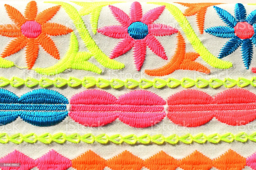 background with floral embroideries bright colors stock photo