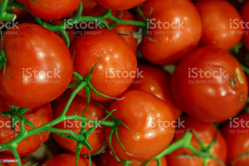background with fresh red tomatoes in market stock photo