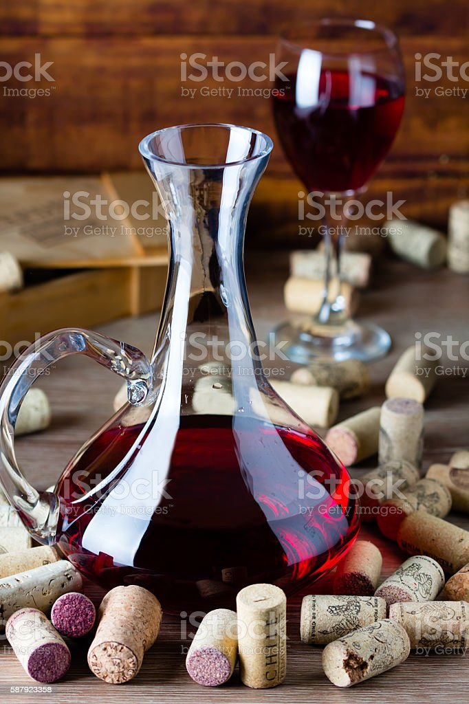 Background with glass of wine, decanter and corks stock photo
