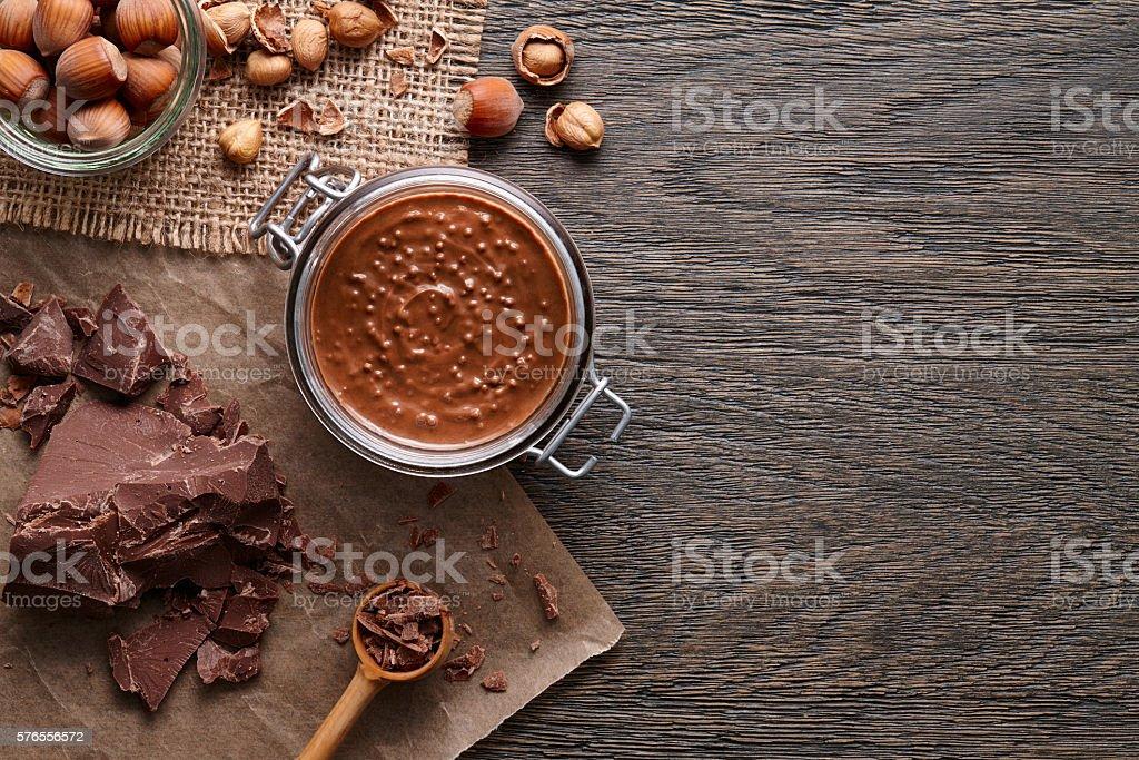 Background with hazelnut spread and ingredients stock photo