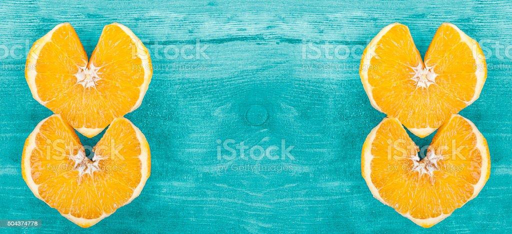 Background with heart shape orange slices. stock photo