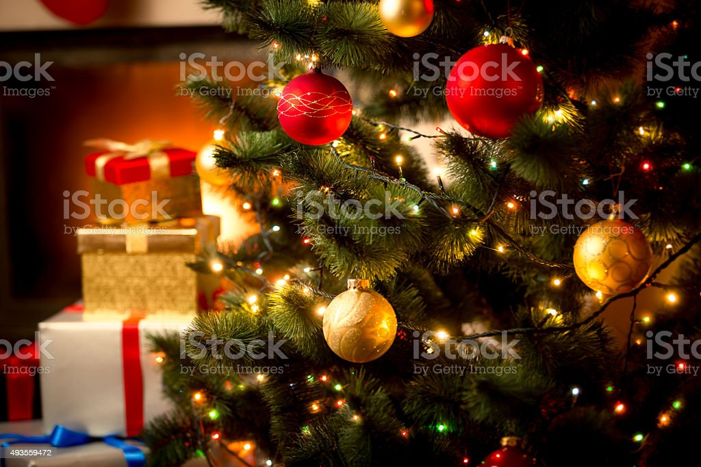 background with illuminated fir tree and fireplace at house stock photo