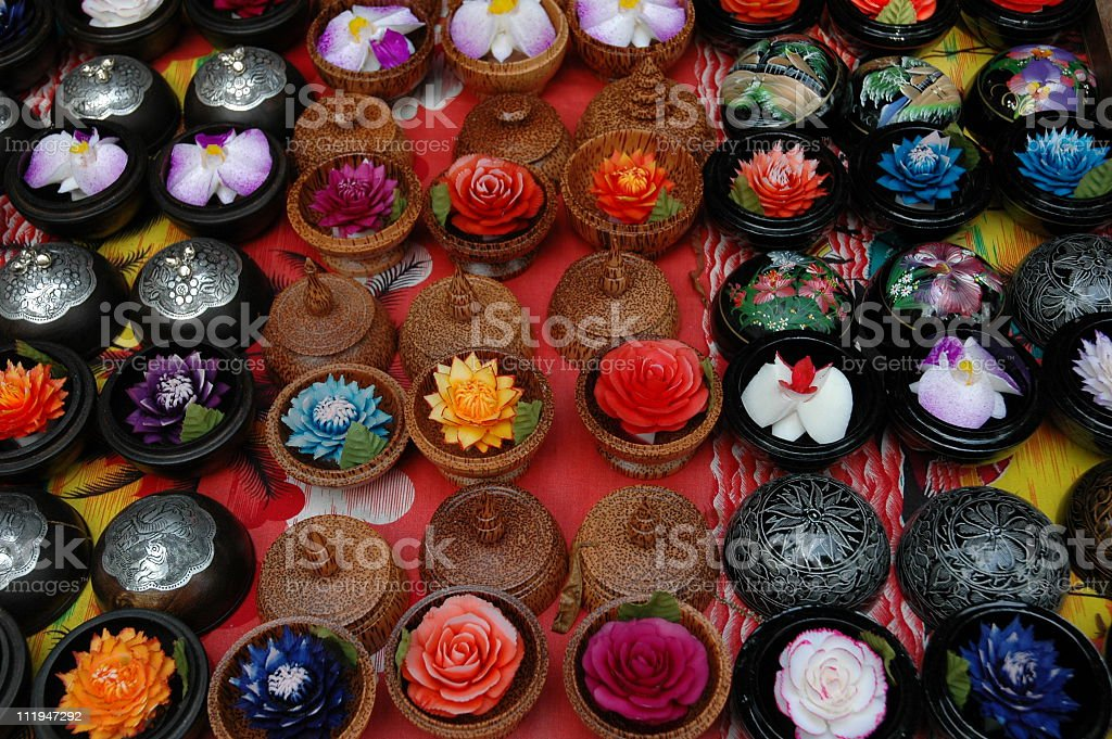 Background with multicolored carved soaps, koh Samui,Thailand stock photo