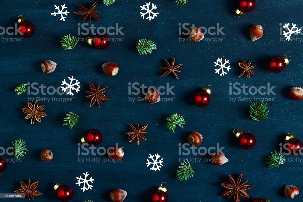 Background with nuts, balls, fir-tree branches and star anise. stock photo