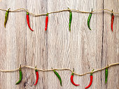 Background with peppers hanging on twine. Flat lay, top view