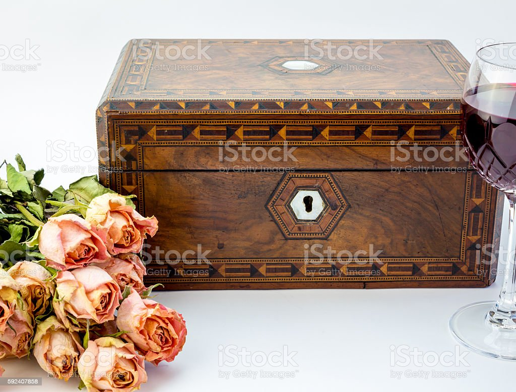 Background with pink dried roses, antique walnut jewelry box wit stock photo