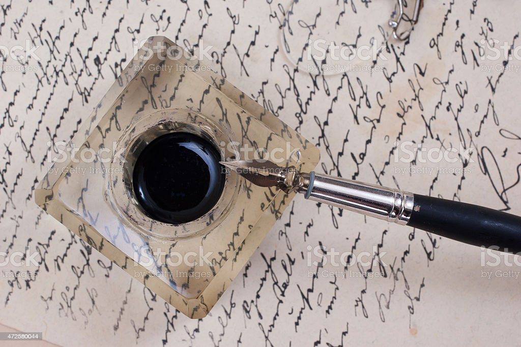 background with retro ink pen on old aged handwriteln letter stock photo