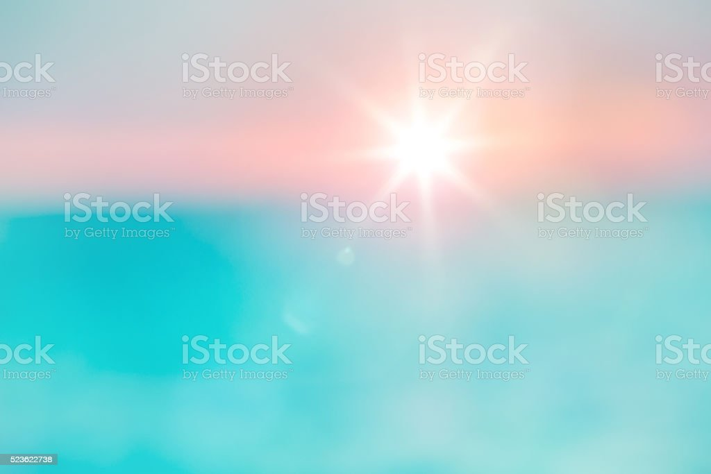 Background with shiny sun with flares over the sea stock photo