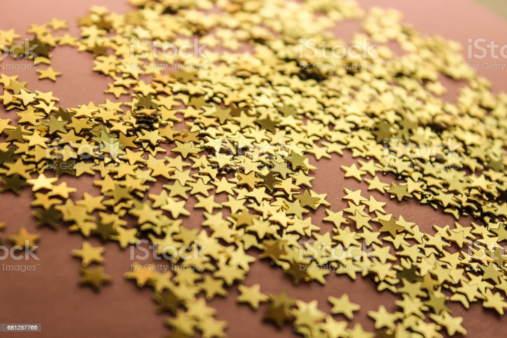 Background with small golden whitish stars on a rosy background stock photo