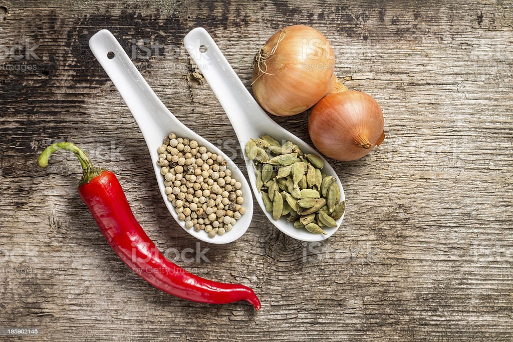 Background with Spices and Vegetables on wood plank royalty-free stock photo