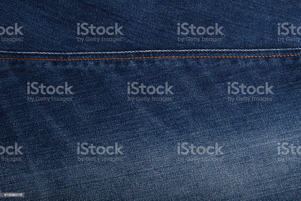 Background with texture of blue denim. Close up stock photo