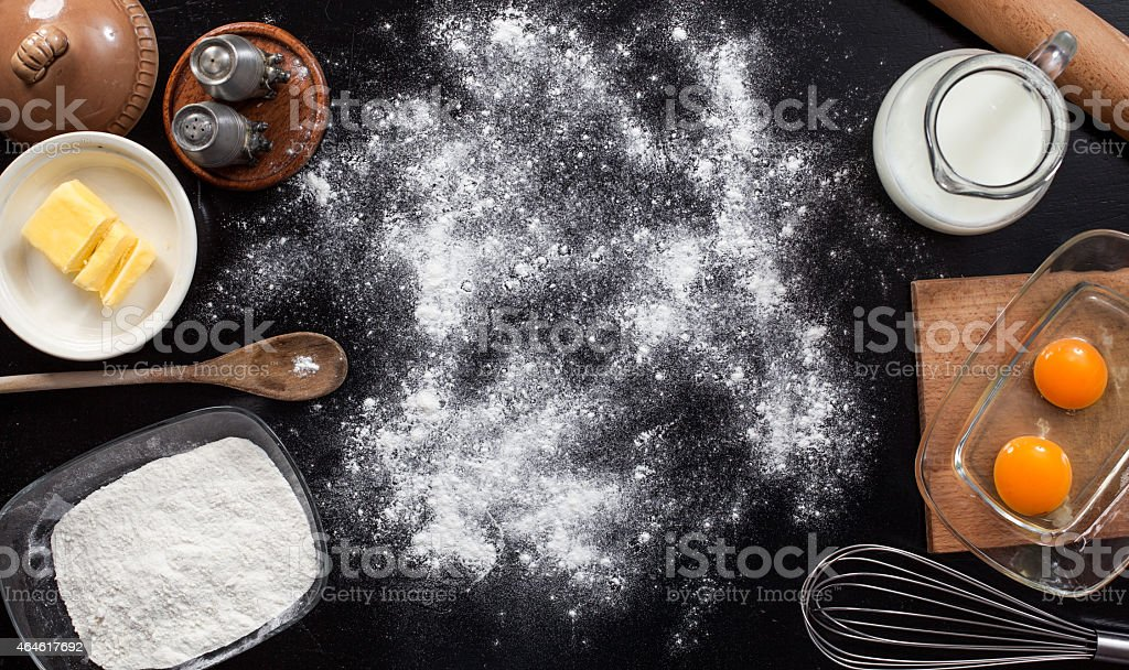 background with the ingredients for a cake stock photo