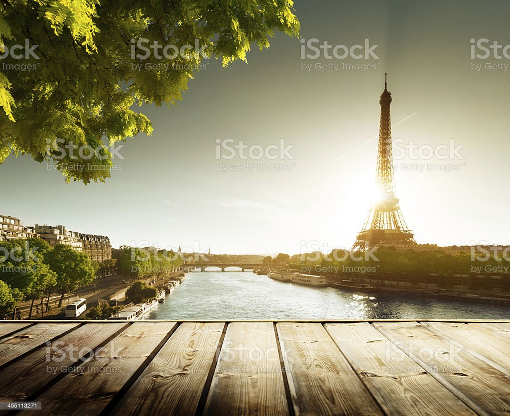 background with wooden deck table and  Eiffel tower in Paris royalty-free stock photo