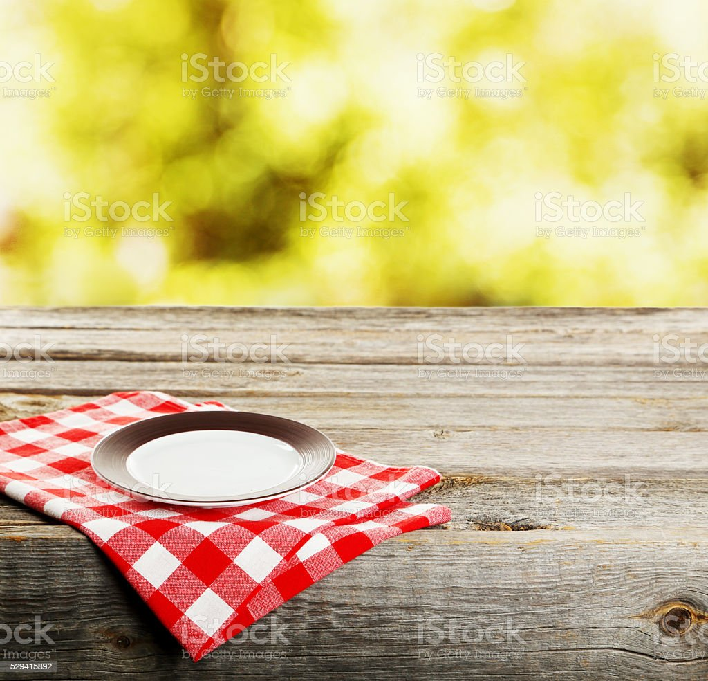 Background with wooden table with white plate stock photo