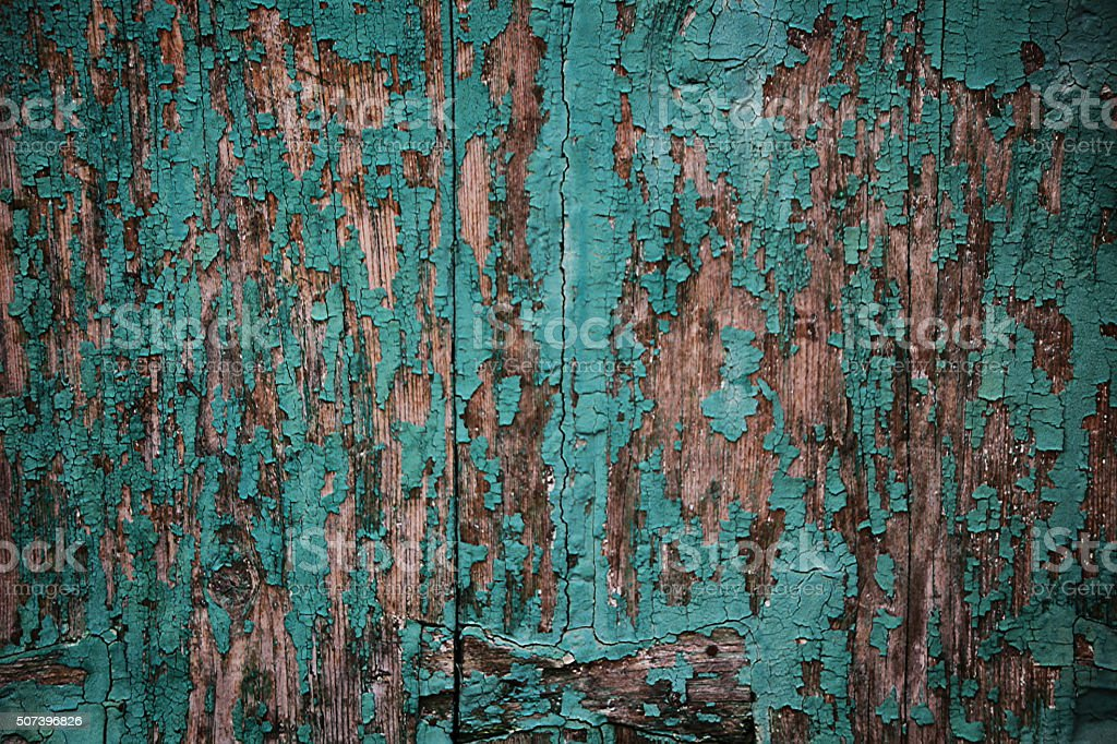 Background - wooden wall with blistered turquoise paint stock photo