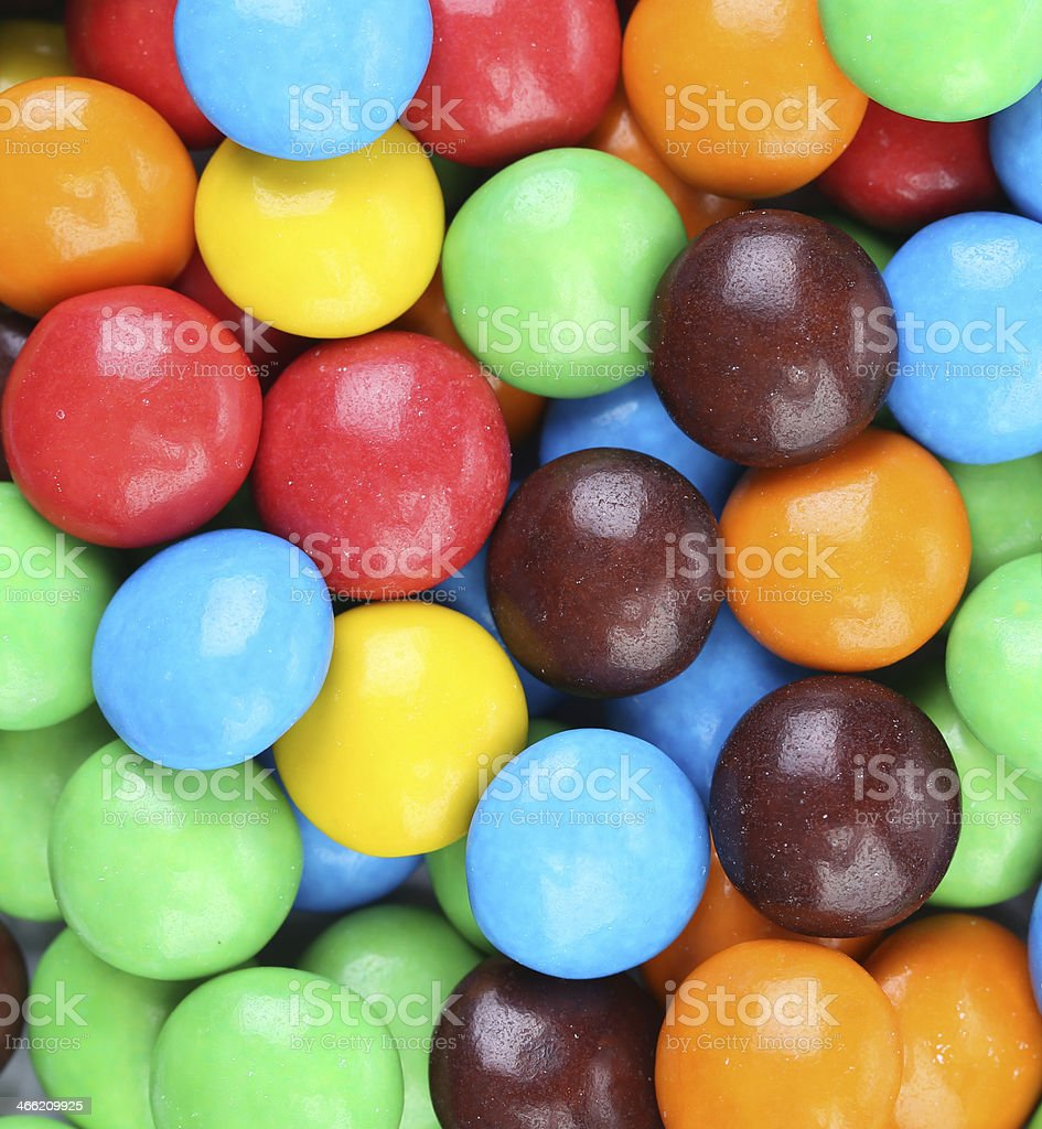 Backgroynd of chocolate balls in colorful glaze. stock photo