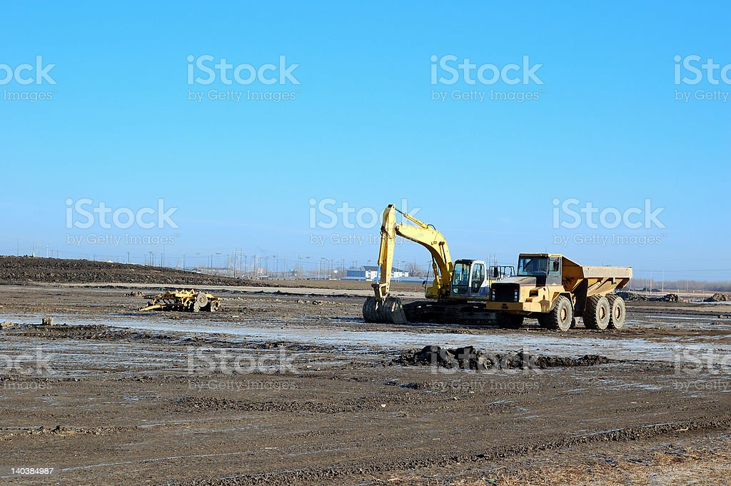 Backhoe and dump truck royalty-free stock photo