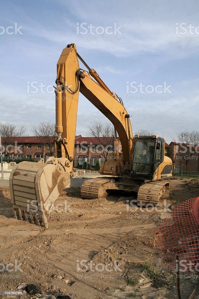 Backhoe at a Construction Site royalty-free stock photo
