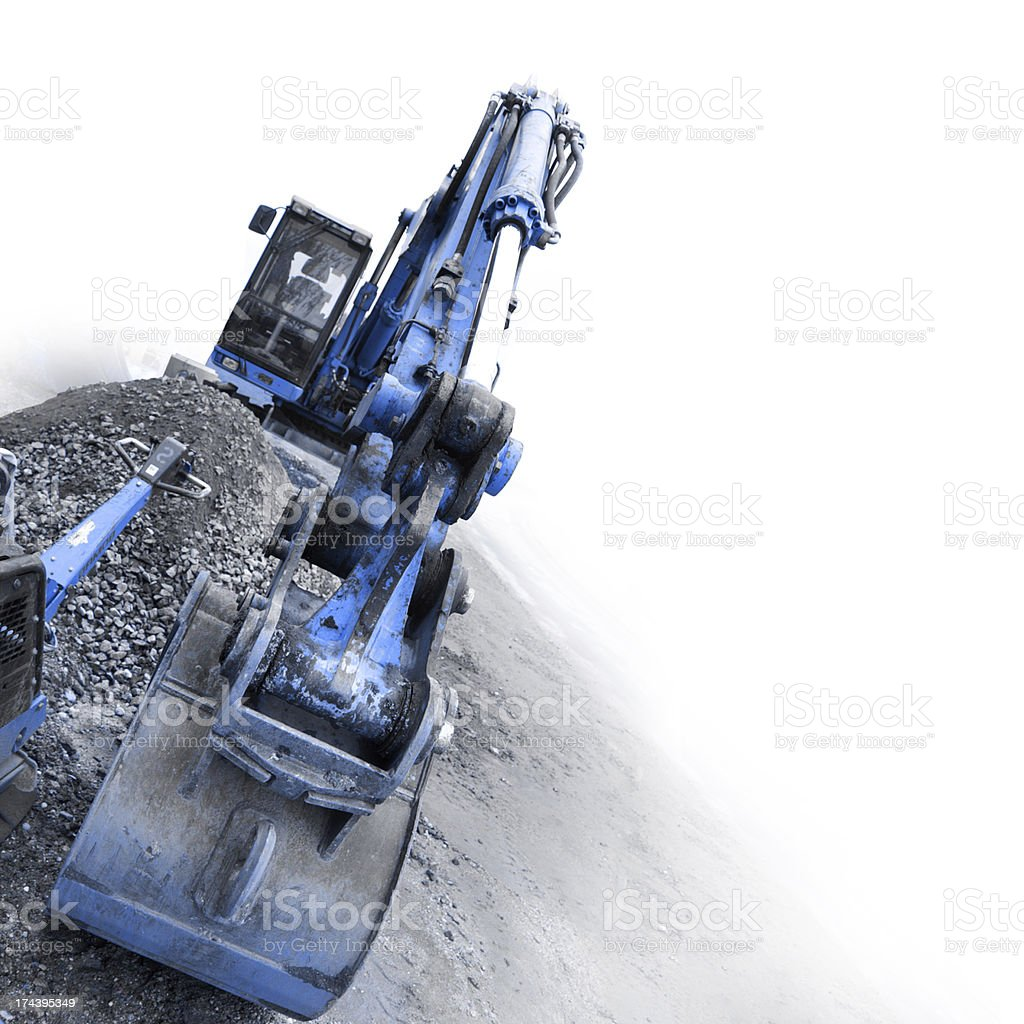 backhoe digging small stones stock photo