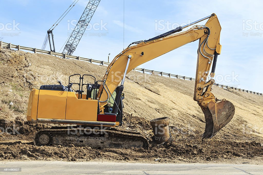 Backhoe excavating dirt stock photo