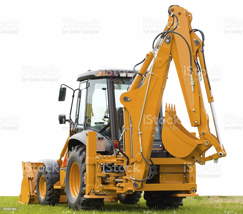backhoe on green grass royalty-free stock photo