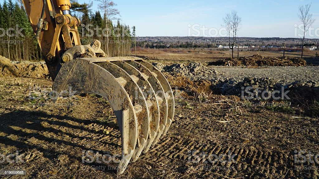 Backhoe Ready for Spring Excavation stock photo