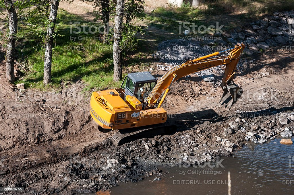 Backhoe working in a river stock photo