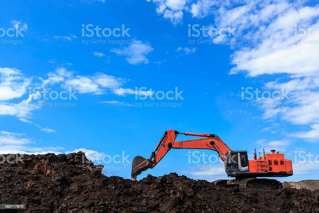 Backhole and Coal stock photo