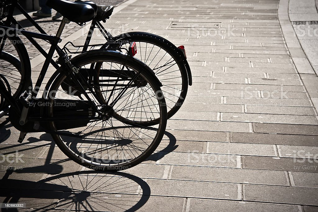 Backlight Parked Bicycles in Ferrara, Italy royalty-free stock photo