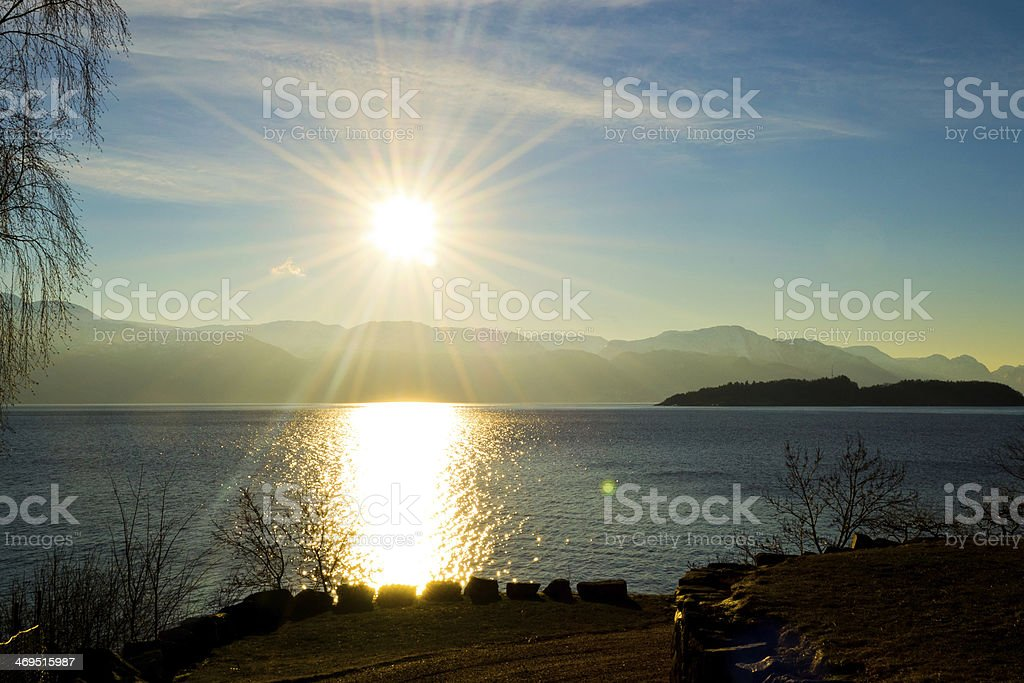 Back-lighting on the fjord royalty-free stock photo