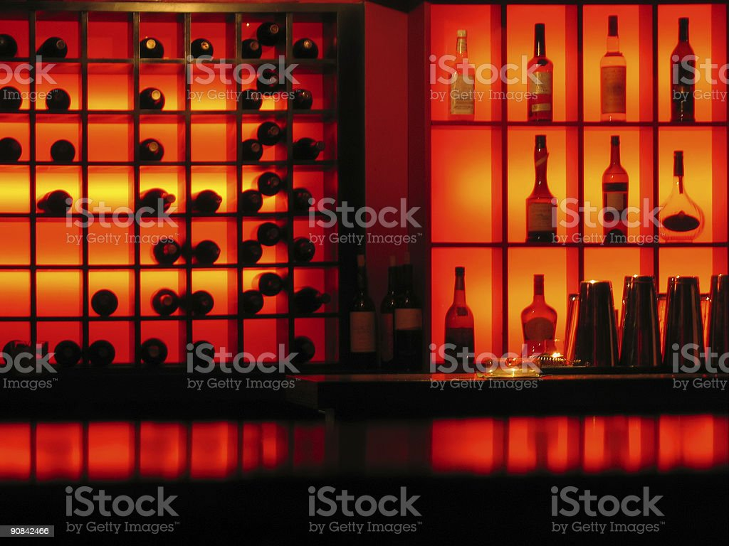 backlights and bottles red club bar background royalty-free stock photo