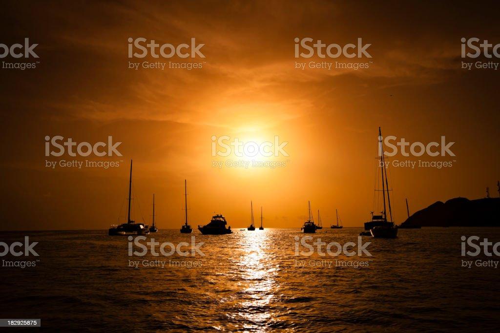 Backlit anchored sailboats royalty-free stock photo