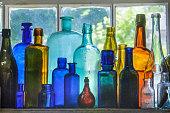Backlit Antique Glass Bottles