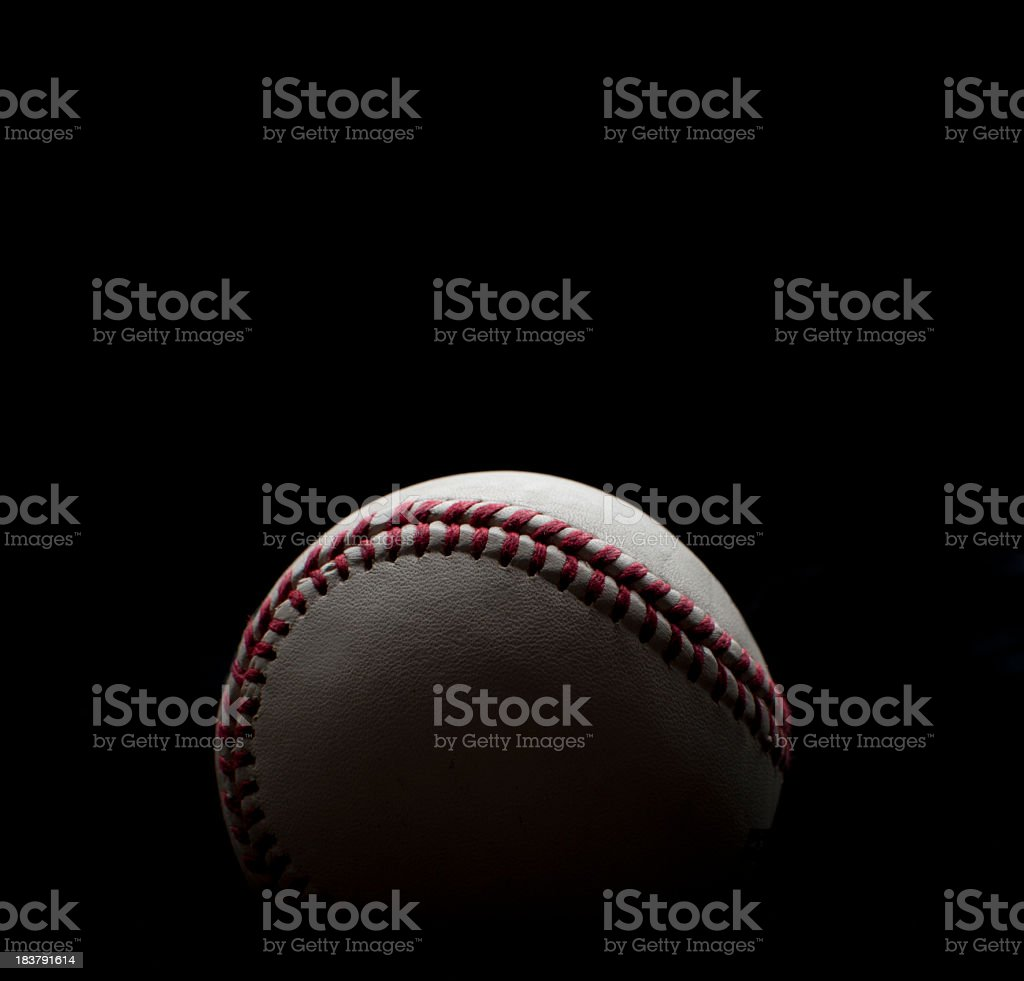 Backlit Baseball shot on a black background stock photo