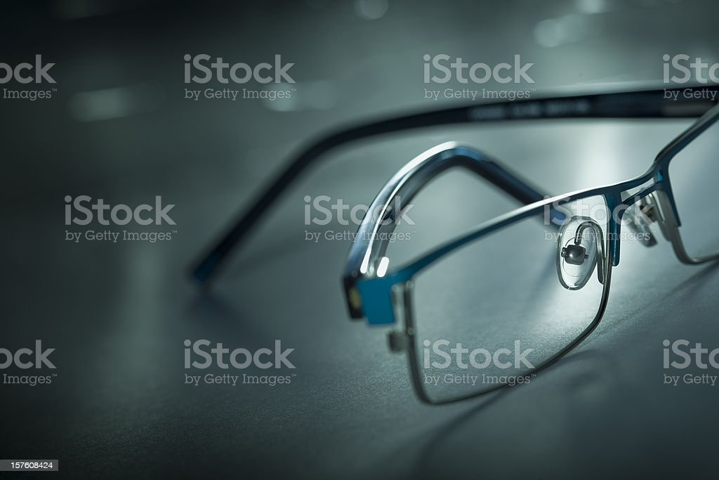 Backlit, close-up image of cool eyeglasses with long shadows stock photo