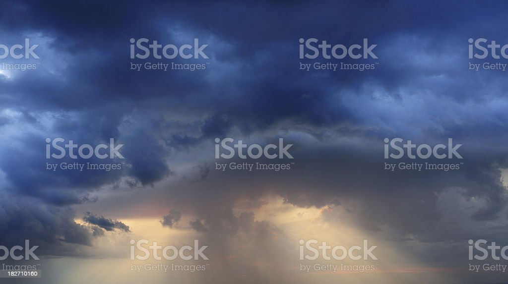 Back-lit dramatic clouds royalty-free stock photo