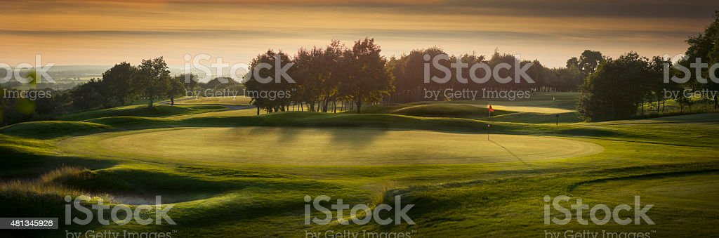 backlit golf course with no golfers stock photo