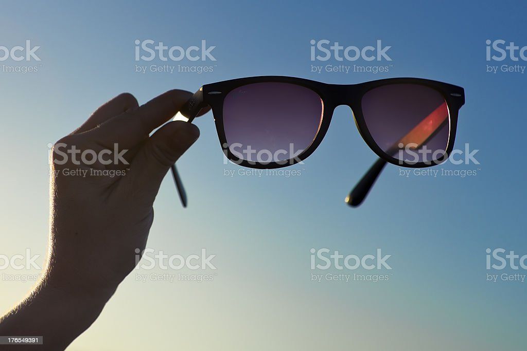 Backlit Hand and Sunglasses 01 royalty-free stock photo