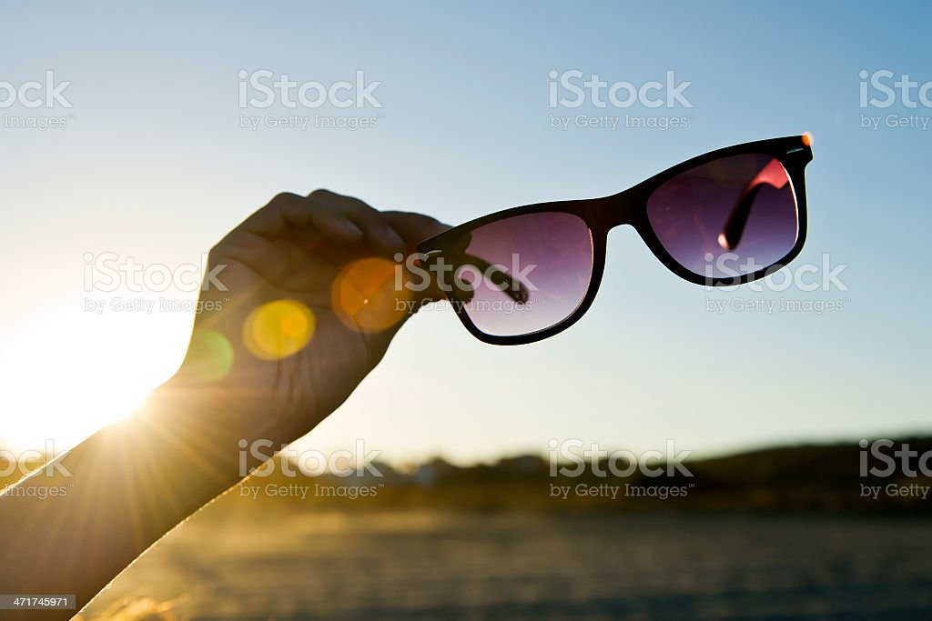 Backlit Hand and Sunglasses 02 royalty-free stock photo