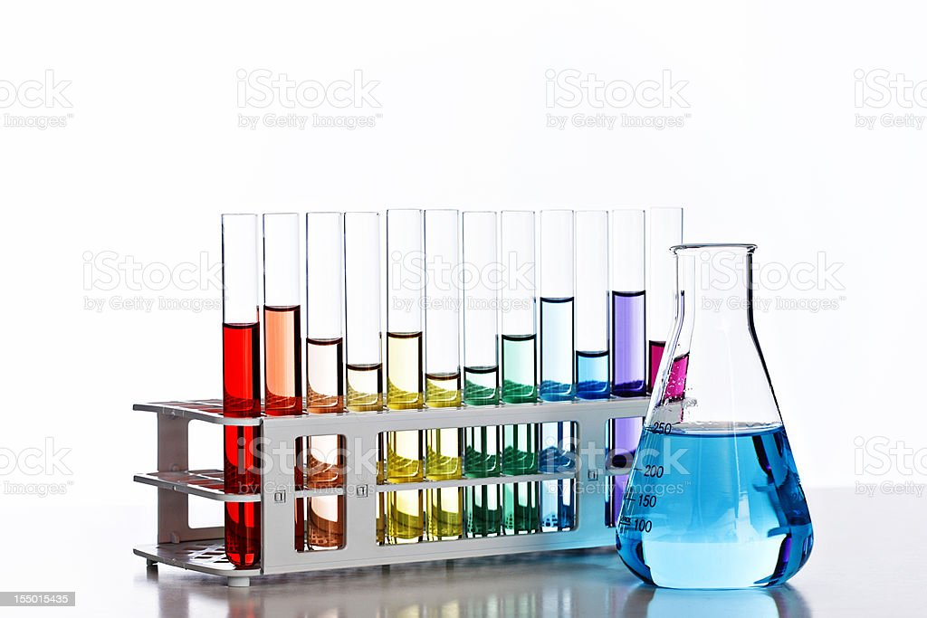 Backlit laboratory glassware containing multicolored liquids royalty-free stock photo