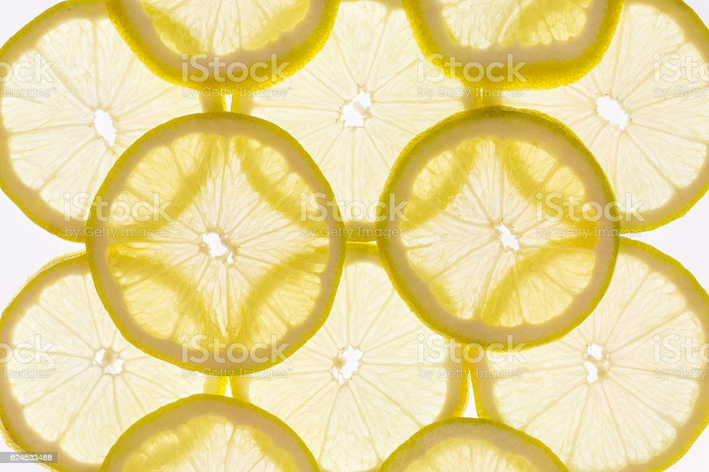 backlit lemon slices stock photo