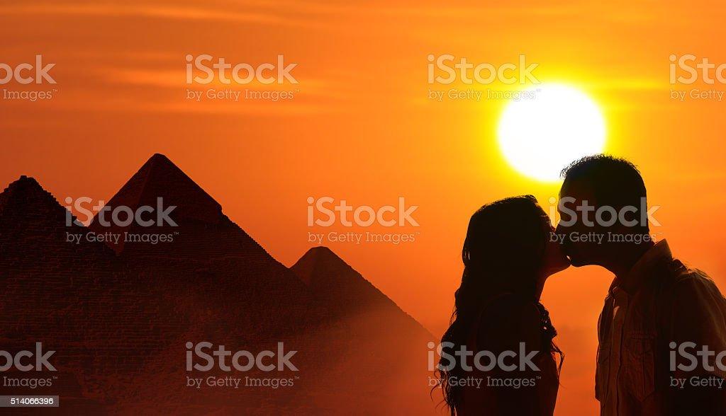 Backlit loving couple honeymoon in Egypt stock photo