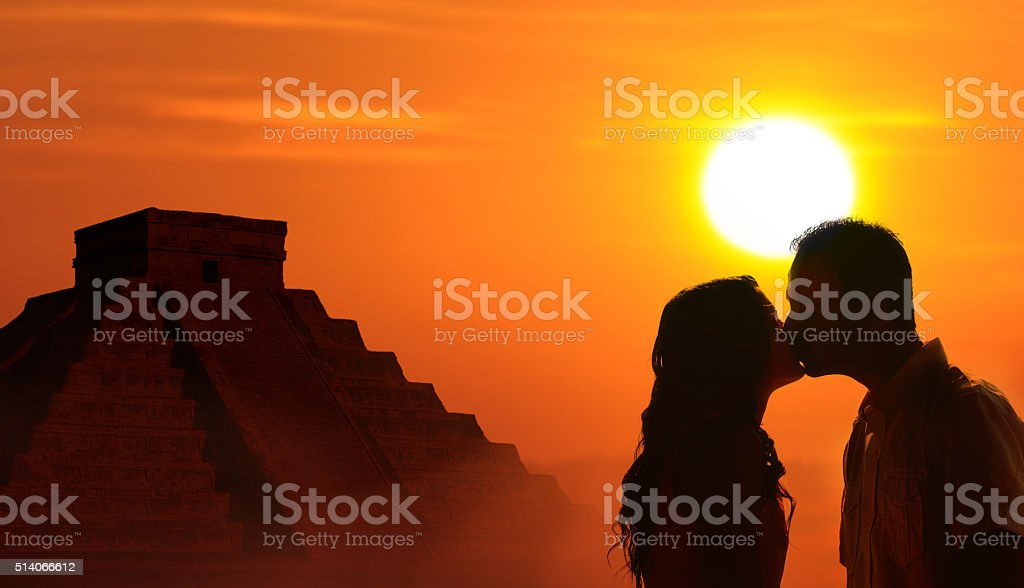 Backlit loving couple honeymoon in Mayan culture stock photo